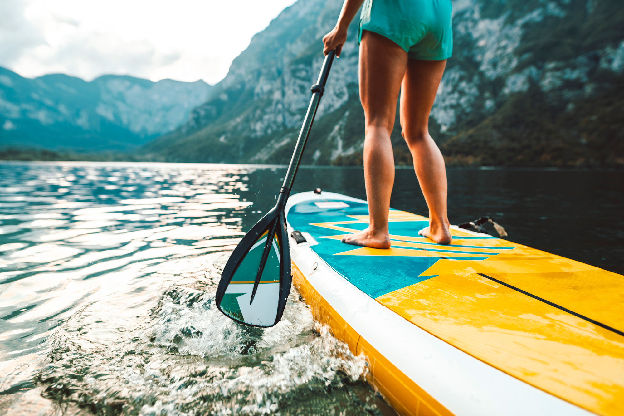 Try Stand Up Paddle Boarding (SUP)